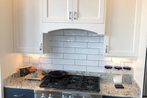 Curb Appeal Construction New Kitchen White Cabinets with Blue Lowers Subway Tile Back splash Eureka