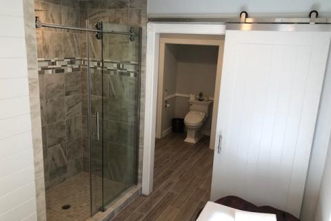 Walk in shower with soft close barn door