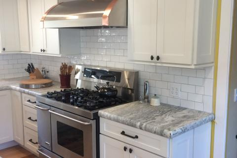 White Suway Tile White Shaker Cabinets Custom Hood Vent With Coper Curb Appeal Construction